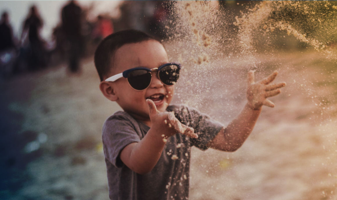 photo of boy-playing-outside-happy