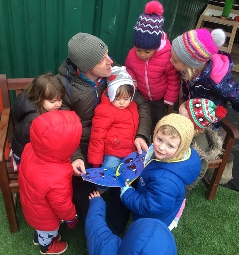 children playing in nursery outside space